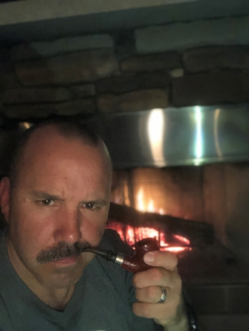 The 2nd most distinguished/interesting man in the world.  Sweet Stache: Check  Manly man pipe: Check  Fire: Check